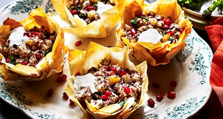 Greek potato and chicken parcels with pomegranate, spinach and sumac